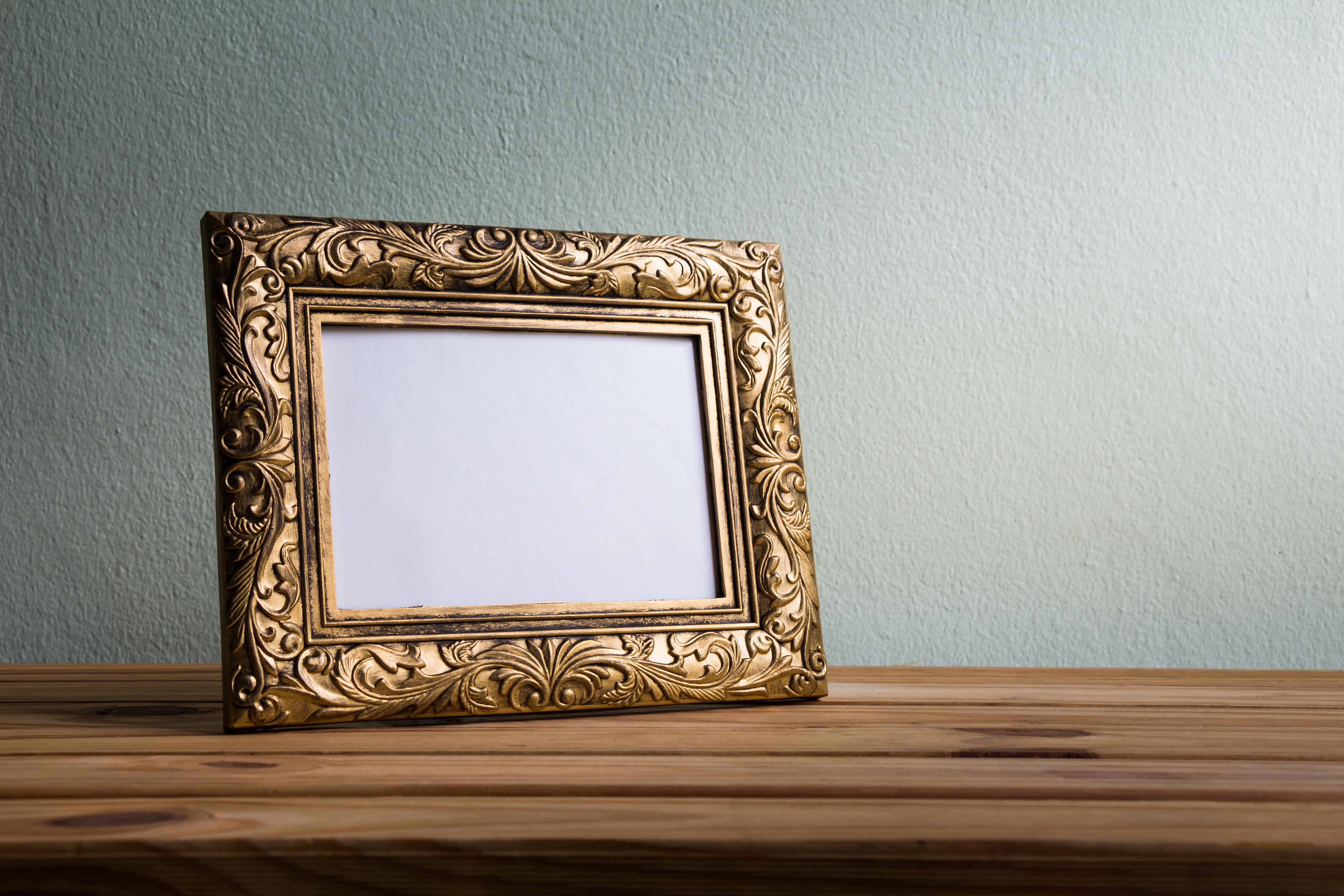 A product photo of a picture frame placed on a counter top