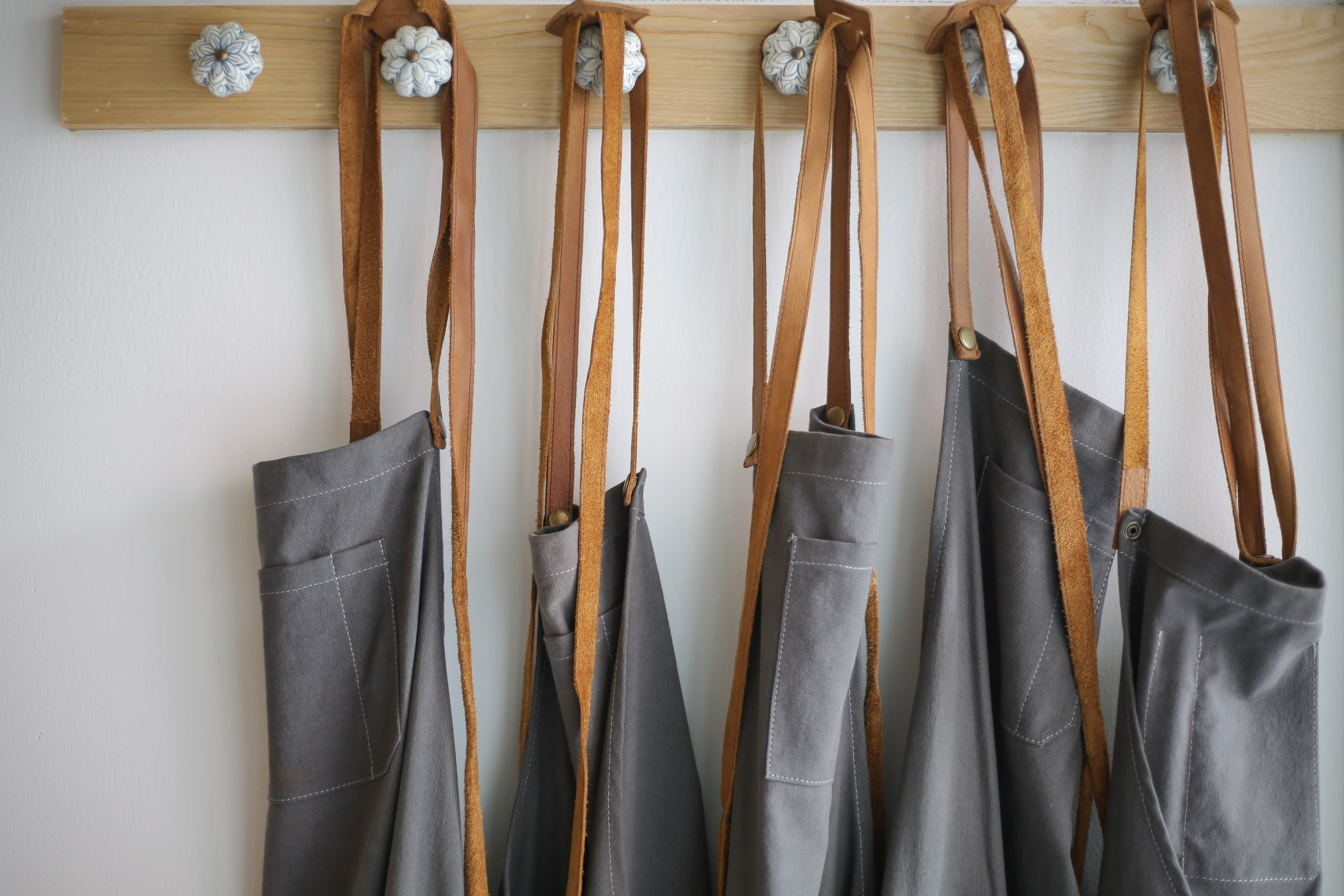 A well lit photo of kitchen clothing, ready to be sold.