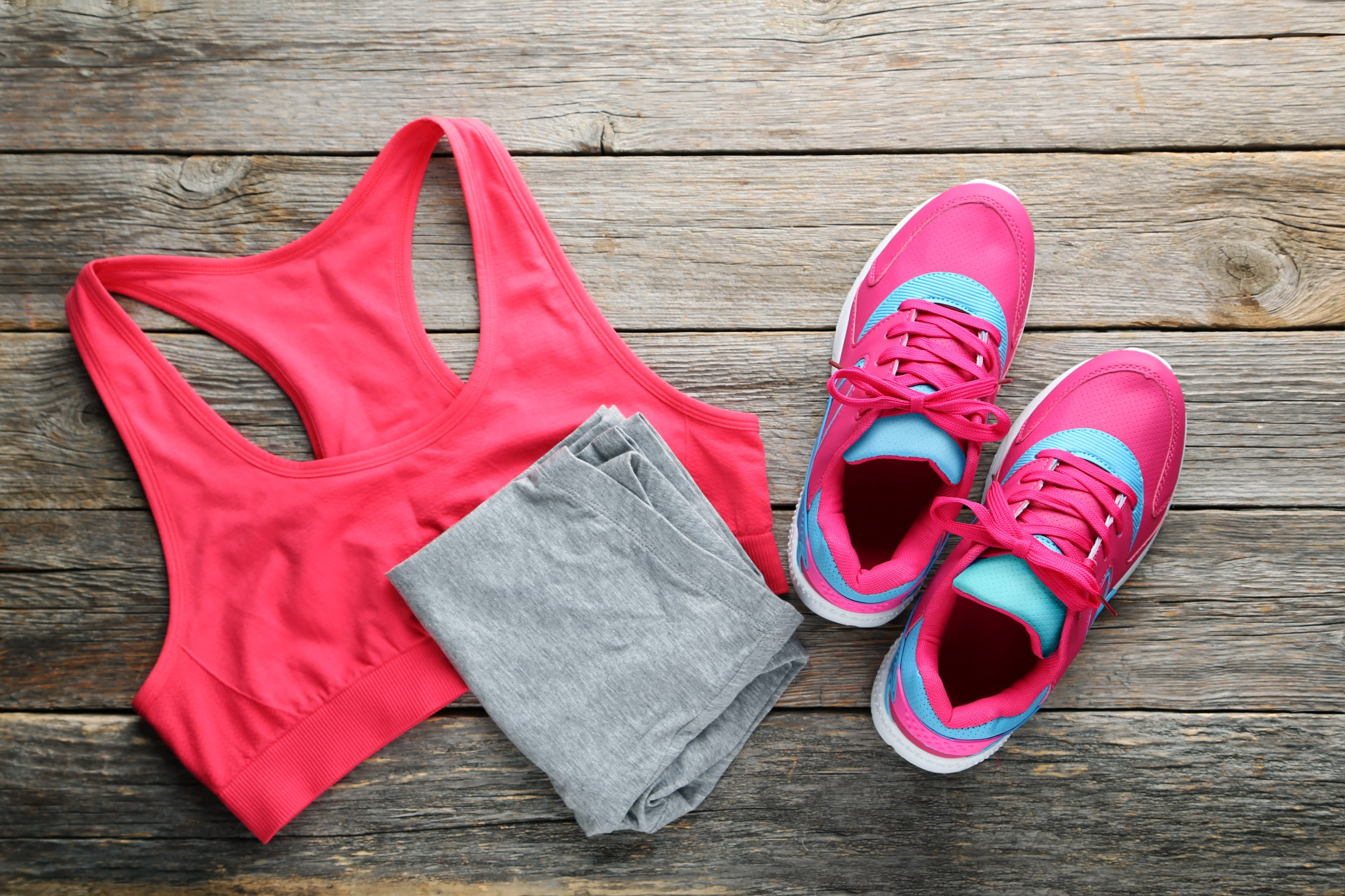 A sports bra, shorts, and running shoes expertly arranged for Product Photography